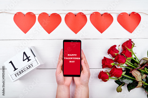 Girl Holding Mobile Phone With Sign Happy Valentines Day In Hands