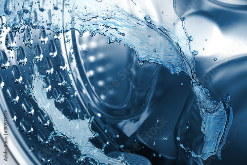 Water splashes in washing machine drum, closeup