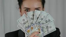 Happy Business Woman Displayin...