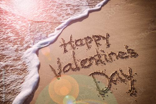 Happy Valentine S Day Message Handwritten On Smooth Sand Beach With