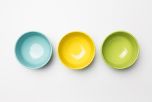 Colored Bowls On White Background