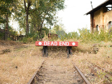 Dead End Sign At A Train Station