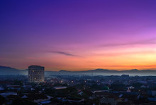 Landmark Of Purwokerto City In Banyumas Regency, Central Java At Dawn Before Sunrise. Cityscape Aerial View In Misty Morning