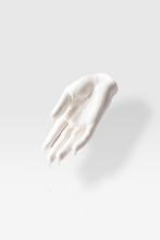 Abstract Sculpture In Shape Of Human Palm In White Paint On White