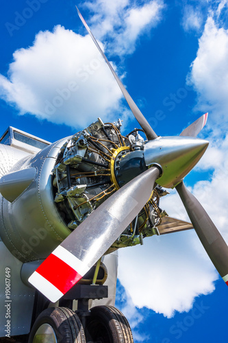 In de dag Ballon Close up view of airplane biplane with piston engine and propeller on a cloudy sky background