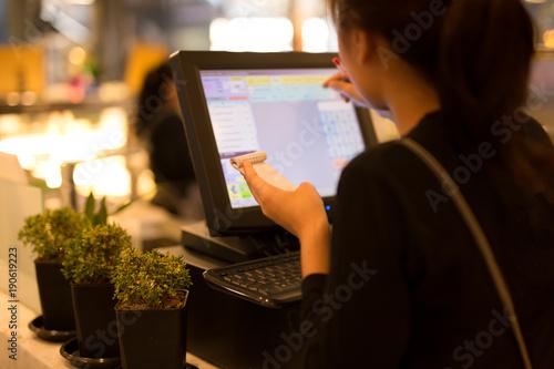 Fotografija  Selected focus on the bills waitress preparing bill at restaurant