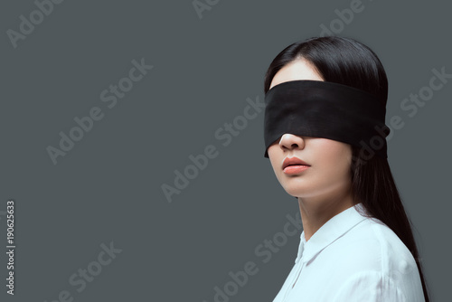 740394e04ea Photo young woman wearing black blindfold isolated on grey