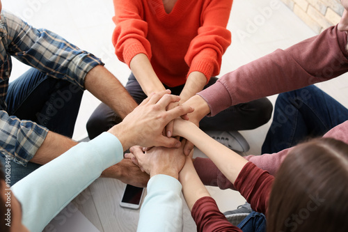 Fototapety, obrazy: People putting hands together, closeup. Unity concept