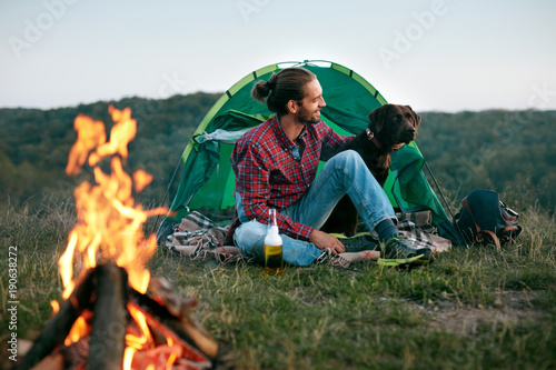 Man Traveling With Dog, Camping In Nature.