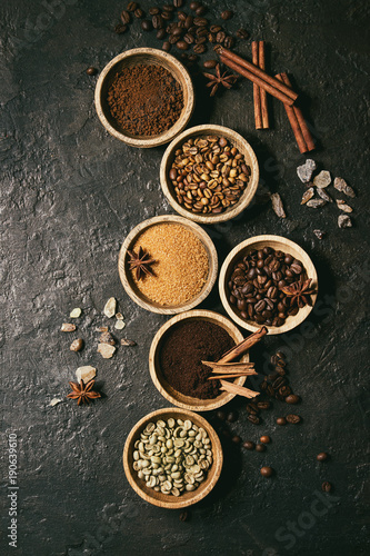 Printed kitchen splashbacks Spices Variety of grounded, instant coffee, different coffee beans, brown sugar, spices in wooden bowls over dark texture background. Top view, space. Toned image