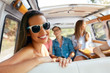 Summer Travel. Happy Woman Having Fun WIth Friends In Car