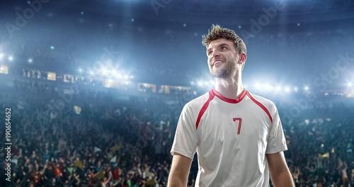 Fotografie, Obraz  Happy soccer player on a football stadium