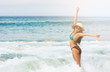 Asian woman on beach are Lifting arms for Happiness and relax on beach while happy vacation or weekend on sunny days and nice weather in travel and holiday concept.