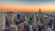 New York City skyline with urban skyscrapers, panorama at sunset.