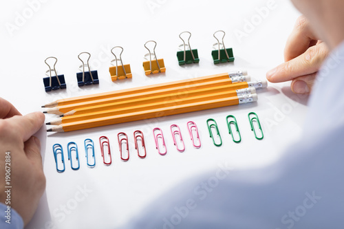 Businessman Arranging The Pencils In Between Colorful Pins Fototapet