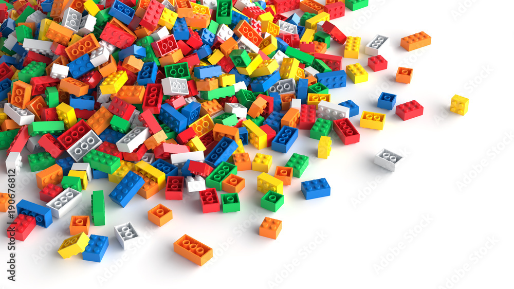 Fototapety, obrazy: Pile of colored toy bricks on white background.
