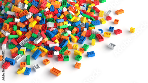 Pile of colored toy bricks on white background. Tableau sur Toile