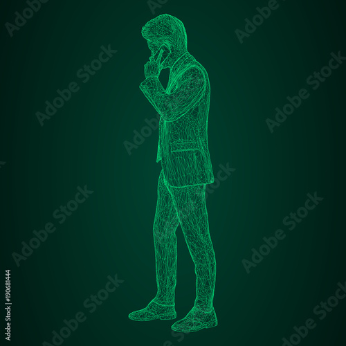 Stampa su Tela  Male businessman in a standing and talking on the phone