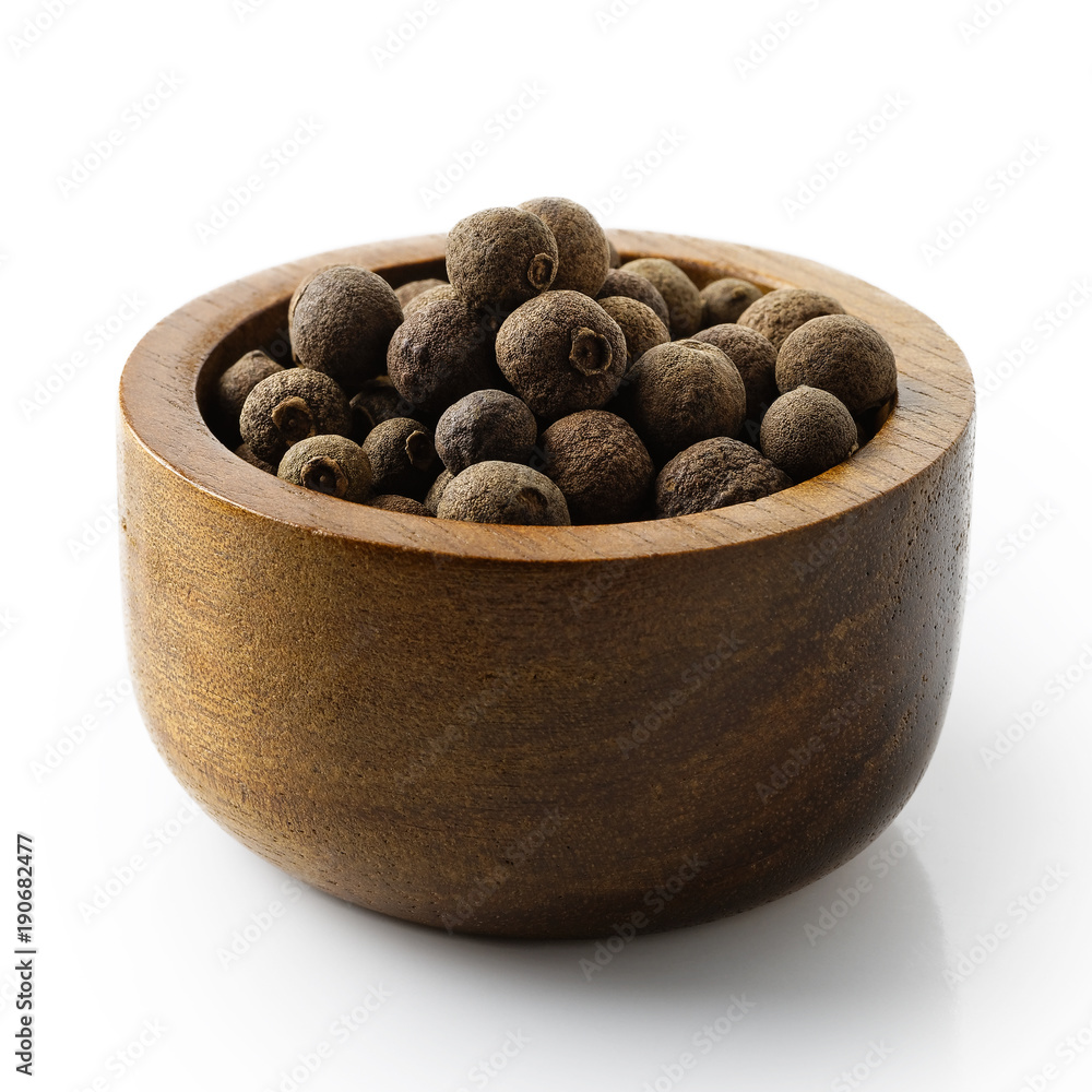 Fototapety, obrazy: Whole allspice in dark wood bowl isolated on white.