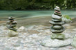 Stack of stones near water stream in Soca valley, Slovenia