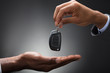 Hand Passing Car's Key To New Owner