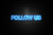 Follow Us Neon Sign On Brickwall