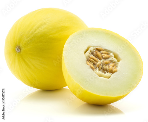 Photo  Yellow honeydew melon and one half with seeds isolated on white background