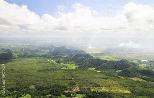 Tablou Canvas Large hills and burning fields are seen from the air during an aerial survey in central Belize