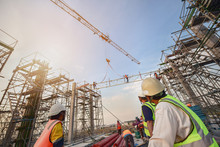 Civil Engineer And Safety Officer Inspection Construction Worker Teamwork  Election Steel Truss In Construction Site