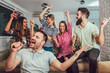 canvas print picture - Group of friends playing karaoke at home. Concept about friendship, home entertainment and people