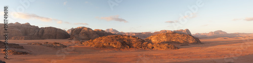 Fotobehang Zandwoestijn panoramic view of wadi rum desert at sunrise