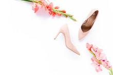 Pale Pink Female Shoes Decorated With Pink Gladioli On White Background. Flat Lay, Top View Trendy Fashion Feminine Background. Beauty Blog Fashion Concept.