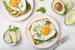 canvas print picture - toast with avocado, spinach and fried egg