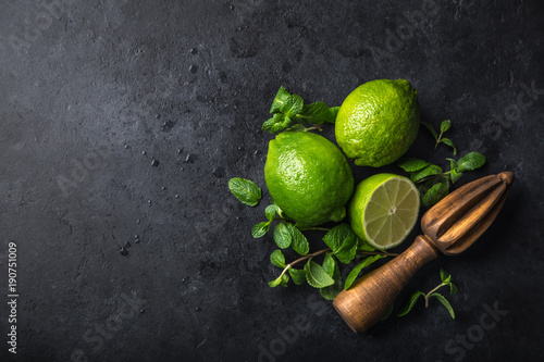 Fotografie, Obraz  fresh green lime and mint on black background, top view, square image