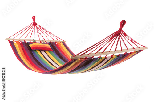 Photographie a multi-colored hammock made from natural fabric hanging on ropes, white backgro