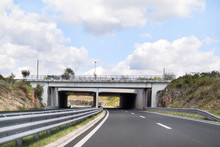 Scenic View On Overpass And Highway Road Leading Through In Croatia, Europe / Beautiful Natural Environment, Sky And Clouds In Background / Transport And Traffic Infrastructure / Signs And Signaling.
