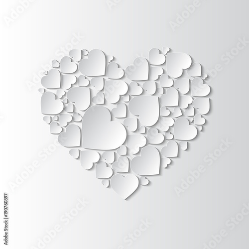 Fotografía  Beautiful paper cut out heart with many small white hearts on white background
