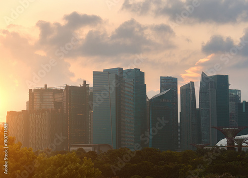Fototapety, obrazy: Business buildings in city at sunset