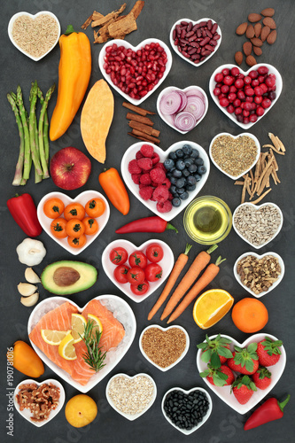 Foto op Aluminium Assortiment Food for a healthy heart with fruit, vegetables, fish, nuts, seeds, pulses, cereal, medicinal spices and herbs. Super food very high in omega 3, antioxidants, anthocyanins, fibre and vitamins.