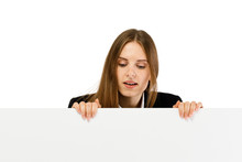 Young Attractive Girl Peeking Behind Blank Board On White Background