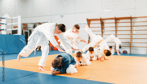 Photo Stands Martial arts Kid judo, childrens in kimono training martial art