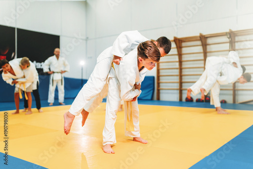 Photo Stands Martial arts Kid judo, young fighters on training, self-defense