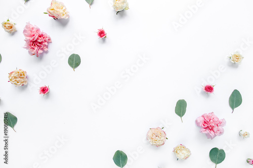 Foto op Canvas Bloemen Border frame with pink rose flower buds and eucalyptus branches isolated on white background. Flat lay, top view. Floral background. Floral frame. Frame of flowers.