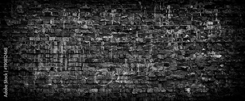 Photo sur Toile Brick wall Black grunge brick wall panoramic background.
