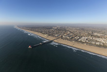 Aerial View Of Huntington Beach Pier In Orange County On The California Pacific Ocean Coast.