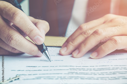Close up business man reaching out sheet with contract agreement proposing to sign Canvas Print