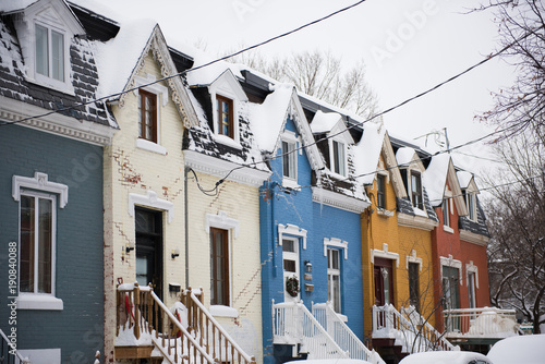 Colorful typical row houses in Plateau Mont-Royal neighborhood in Montreal, Quebec, Canada during winter