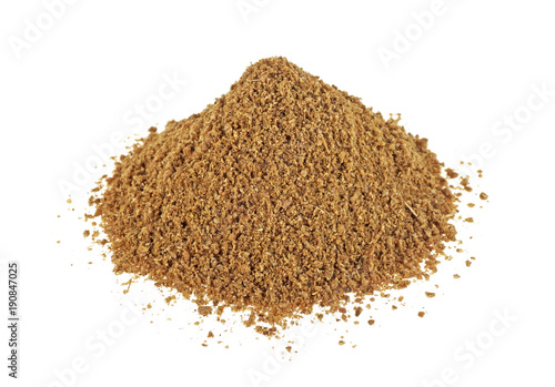 Heap of raw organic coriander powder on a white background