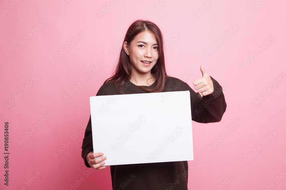 Fototapety, obrazy: Young Asian woman show thumbs up with  white blank sign.