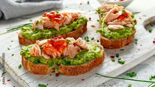Homemade Toast sandwich with Salmon, Avocado and chilli jam on wihte wooden board Tapéta, Fotótapéta